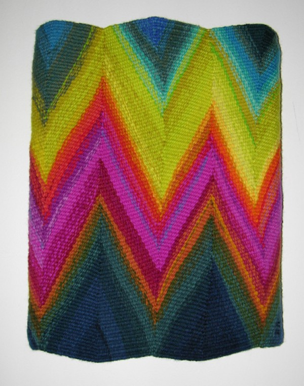 Small wedge weave tapestry with skewed rainbow colors
